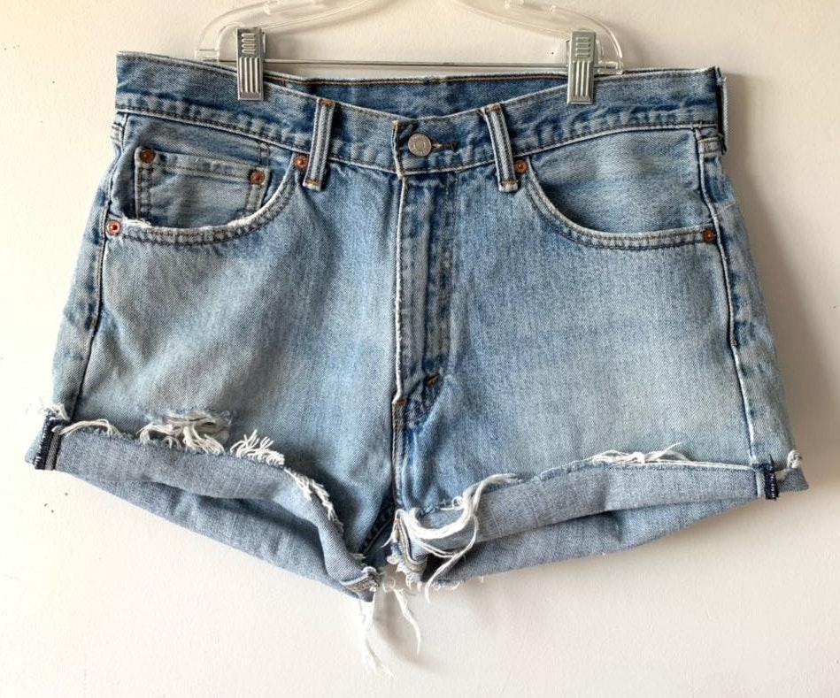 Levi's | 535 Medium Wash Distressed Cutoff Shorts