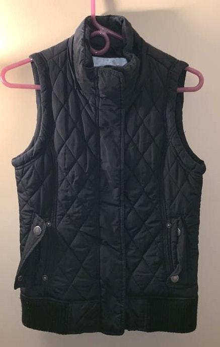 Maurice's black vest