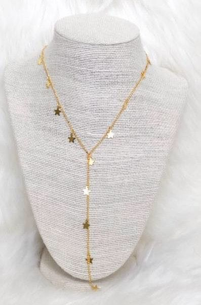 gold star drop necklace
