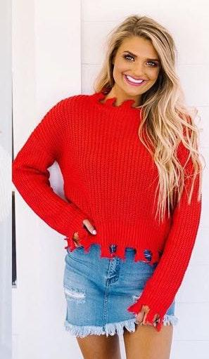 shop these three Red Cropped Sweater